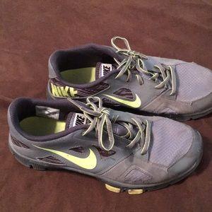 Men's Nike tennis shoes.